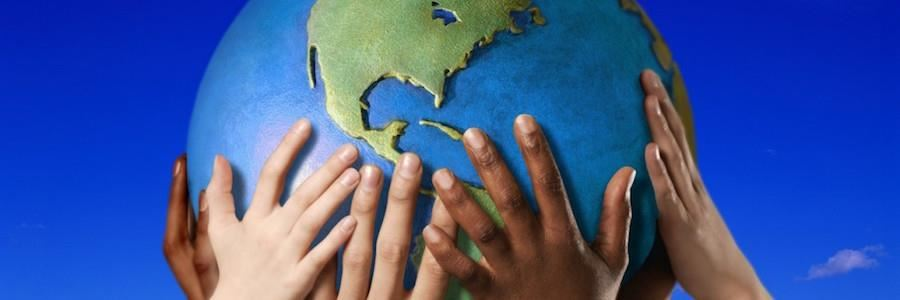Photo of children's hands holding globe